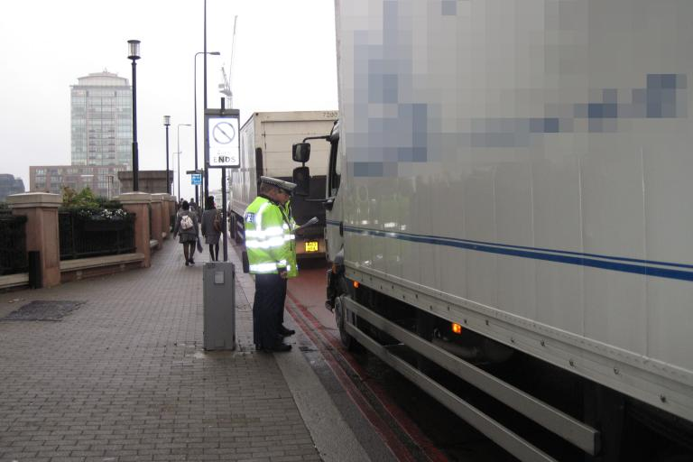 Metropolitan Police officers inspecting a lorry