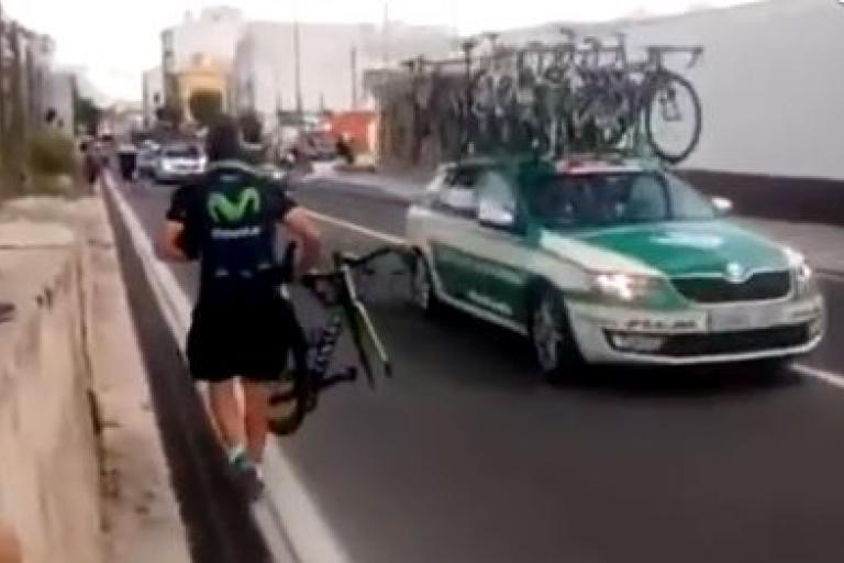 Movistar soigneur with broken bike