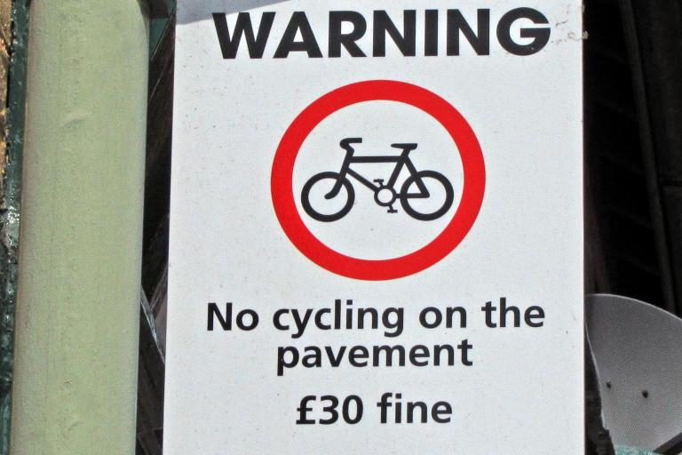 No cycling on the pavement sign (CC licensed by Leo Reynolds:Flickr)