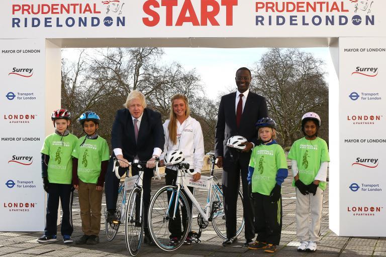 Prudential RideLondon launch, Boris Johnson, Laura Trott and Tidjane Thiam with schoolchildren