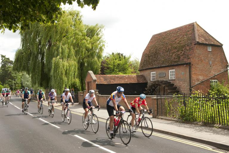 Prudential RideLondon-Surrey 100 - riders passing a mill