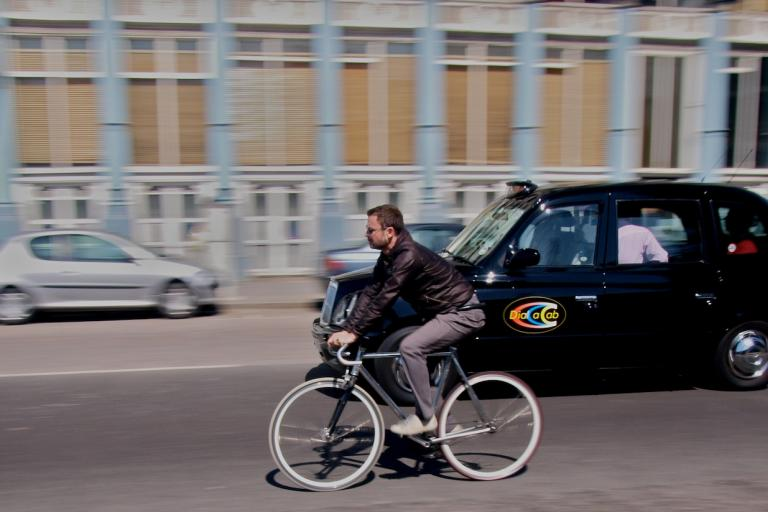 Taxi and Cyclist copyright Simon MacMichael.jpg