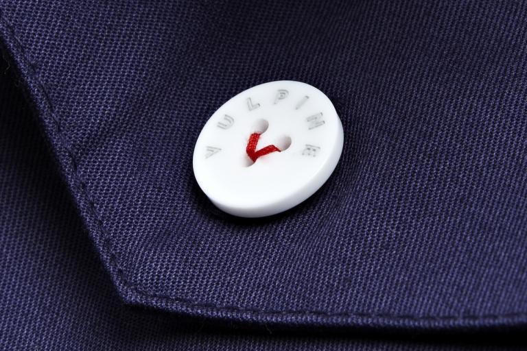 Vulpine v-stitch button