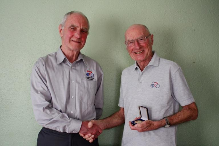 John Else (right) received medallion from Dave Wall former chair of Association of British Cycling Coaches.JPG