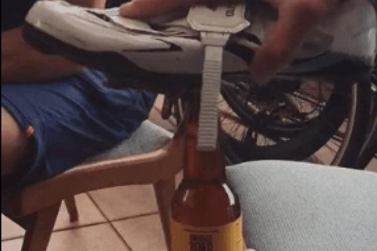 Kristof Allegaert  opening beer bottle (source Juliana Buhring Facebook voide still).PNG