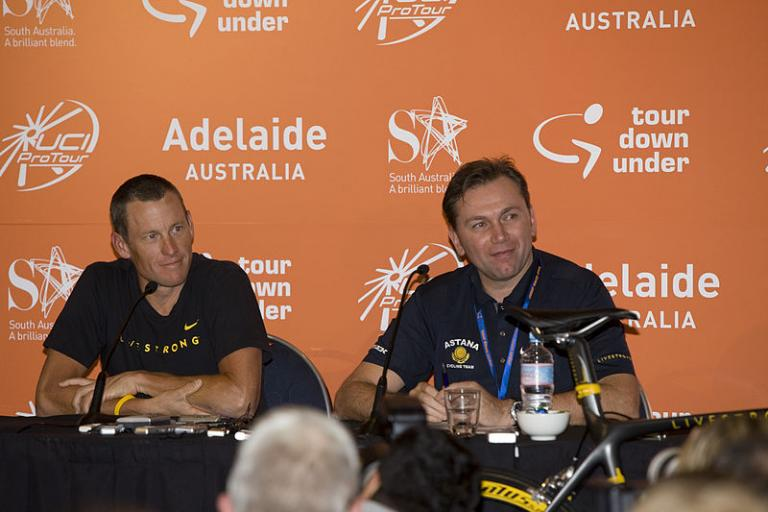 Lance Armstrong and Johan Bruyneel at the 2009 Tour Down Under (licensed CC BY 2.0 on Wikimedia Commons by Paul Coster)