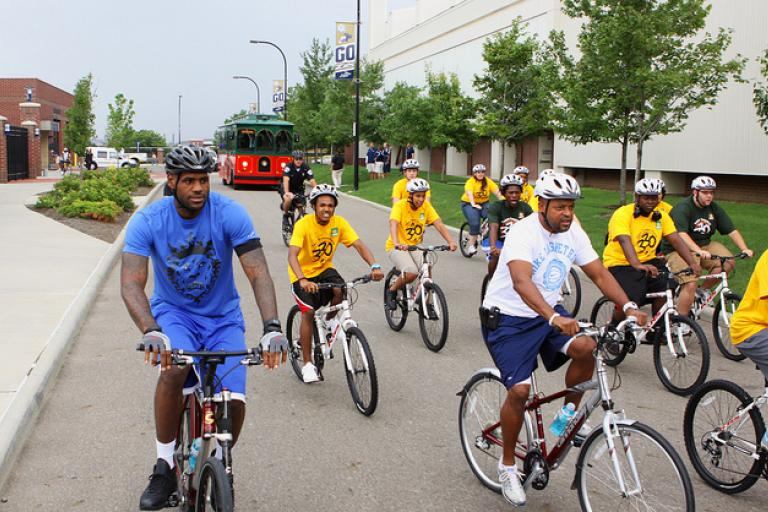 LeBron James (left) on Wheels for Education ride (via State Farm on Flickr)