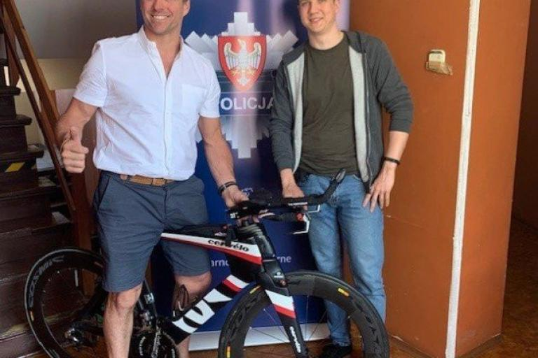 Marc London (left) with Polish police officer and his bike (via Herts Police)