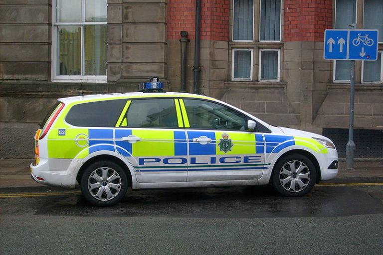 Merseyside Police car (licensed CC BY 3.0 on Wikimedia Commons by John Bradley)
