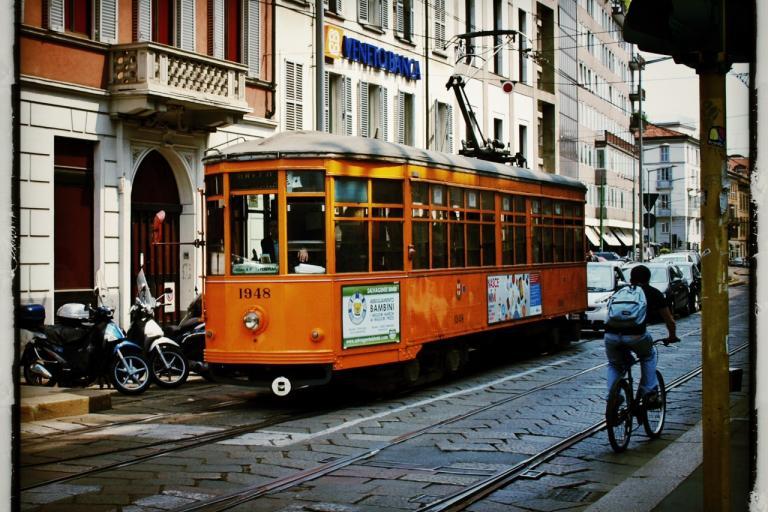 Milan cyclist and tram Copyright Simon MacMichael.jpg