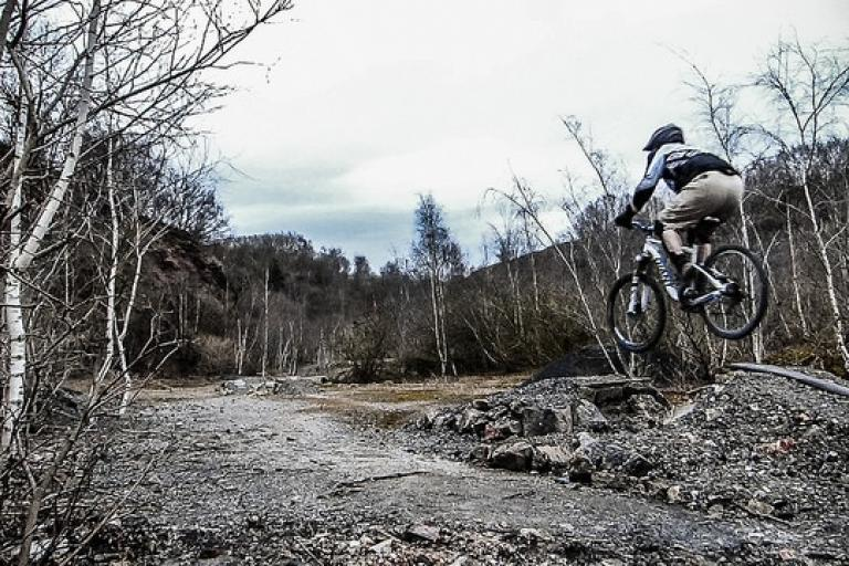 Mountain biking in Forest of Dean (licensed CC BY 2.0 on Flickr by Stewart Black).jpg
