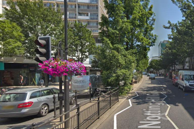 Notting Hill Gate with Eilidh Cairns' ghost bike on the central reservation (via Google Street View).PNG