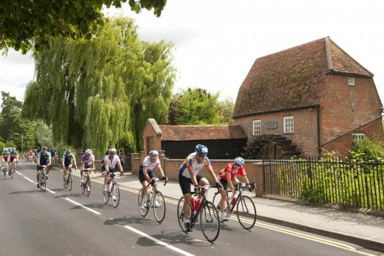 Prudential RideLondon-Surrey 100 - riders passing a mill.jpg