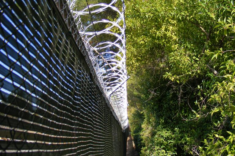 Razor wire (licensed CC BY SA 3.0 by J Smith on Wikimedia Commons)