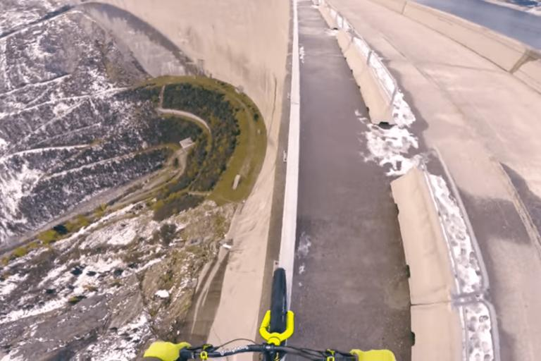 Fabio Wibmer atop Austria's Koelnbreinsperre dam (still from YouTube)