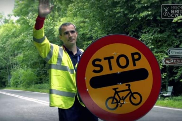 Stop - Cycle Race sign (British Cycling video still).JPG