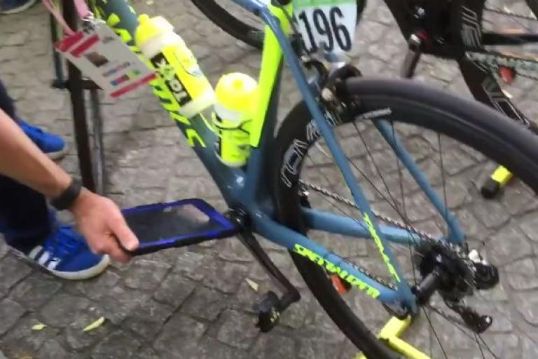 UCI checking Tinkoff bike for hidden motor (source Facebook video still).JPG